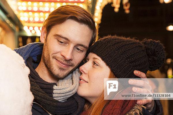 smooching couple on christmas market
