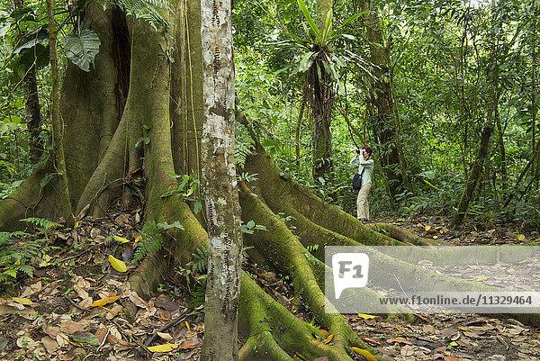woman birding in jungle  Peru
