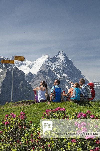 Hiker on Grosse Scheidegg in front of Eiger and monk in the Bernese Oberland  Switzerland