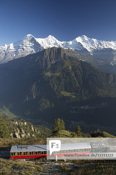 Schynige Platte mountain railroad in front of Eiger  monk and Jungfrau