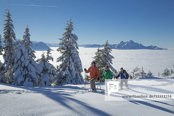 group doing snow shoe tour on Rigi mountain in winter in Central Switzerland