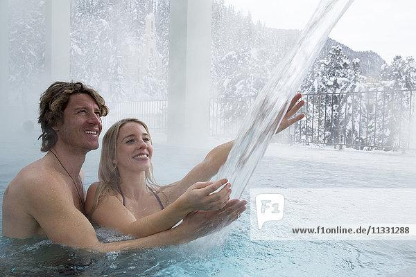 couple in indoor swimming pool OVAVERVA in Saint Moritz