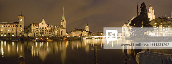 Zurich city with Limmat river in winter by night