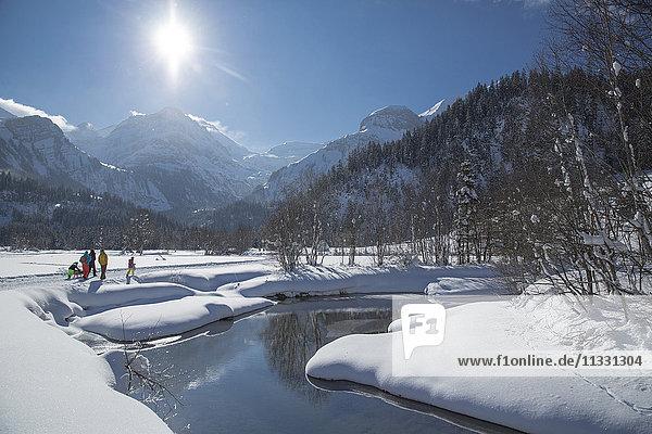 Familiy walking in winter in Lauenen  Switzerland