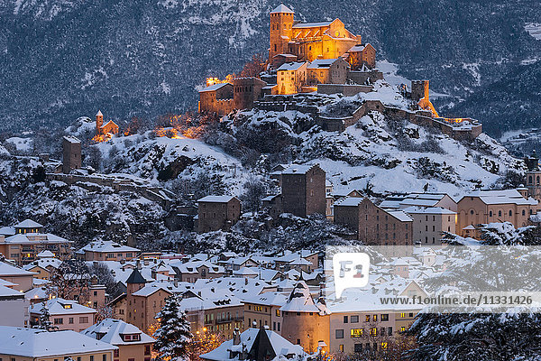 Sion city in Valais in winter by night