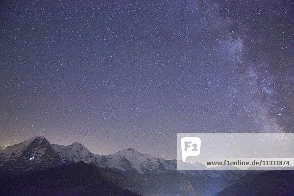 Eiger  Mönch and Jungfrau  mountains and sky with stars in the Bernese Oberland