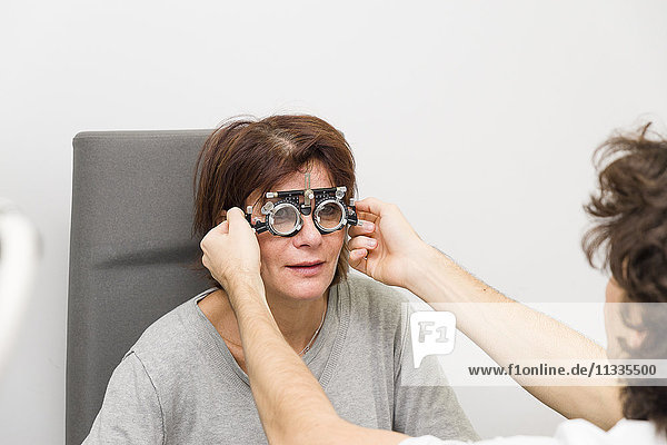 Reportage at the New Vision clinic in Nice  France. This clinic is one of the main centres for refractive surgery in France  with cutting-edge technology for all eye laser operations. Pre-op diagnosis carried out by an optometrist who specialises in measuring the visual system (refraction). Monovision test with trial spectacles.