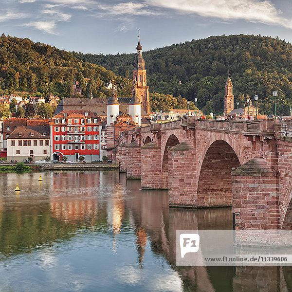 Old town with Karl-Theodor-Bridge (Old Bridge)  Gate and Heilig Geist Church  Neckar River  Heidelberg  Baden-Wurttemberg  Germany  Europe