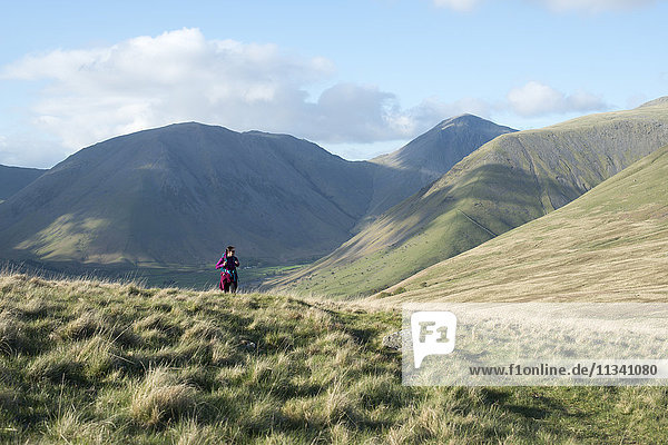 Trekking in the English Lake District in Wasdale with views of Kirk Fell and Great Gable in the distance  Lake District National Park  Cumbria  England  United Kingdom  Euorpe