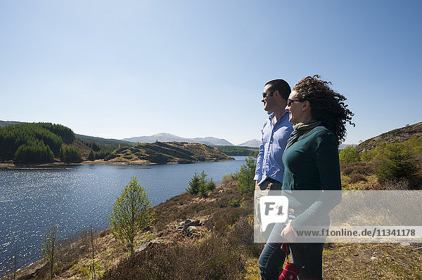 Tourists look out across Loch Laggan  Aberdeenshire  Scotland  Uninted Kingdom  Europe