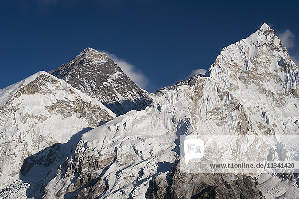 The massive black pyramid summit of Mount Everest seen from Kala Patar with Nuptse the other peak to the right  Khumbu Region  Nepal  Himalayas  Asia