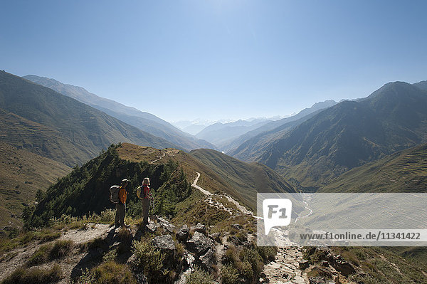 Taking a pause from the trail at a viewpoint in the Juphal Valley  Nepal  Himalayas  Asia