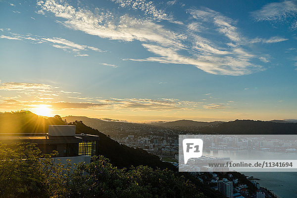 The sun sets over a new home atop Mount Victoria in Wellington  North Island  New Zealand  Pacific