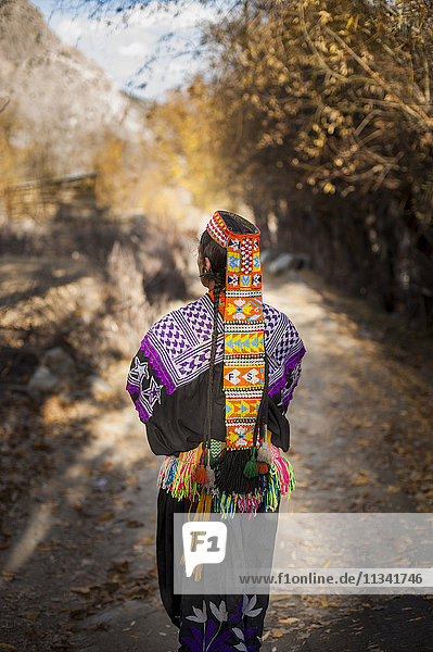 Kalasha woman from Kalasha valley wearing traditional dress  North West Frontier Province  Pakistan  Asia