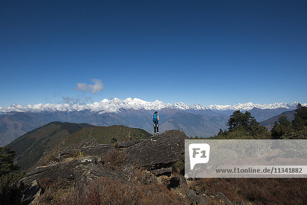 Taking in the view of the Himalayan Range on the trail between Sian Gompa and Gosainkund in the Langtang region  Himalayas  Nepal  Asia