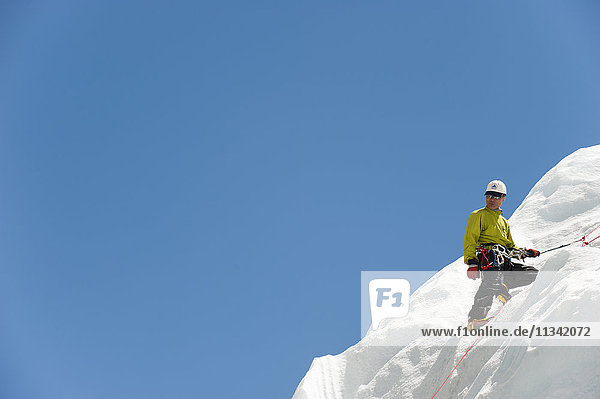 A climber practises on an ice wall in preparation for climbing Everest  Khumbu Region  Nepal  Asia