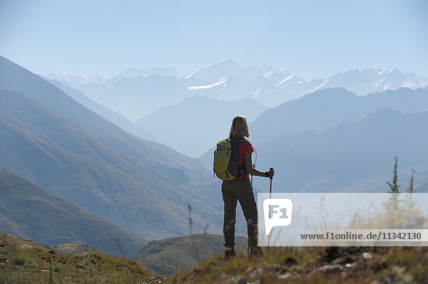Taking a pause from the trail at a viewpoint in the Juphal valley in the remote Dolpa region  Himalayas  Nepal  Asia