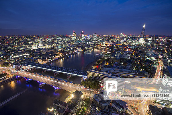A night-time view of London and the River Thames from the top of Southbank Tower including The Shard  St. Paul's Cathedral and Tate Modern  London  England  United Kingdom  Europe