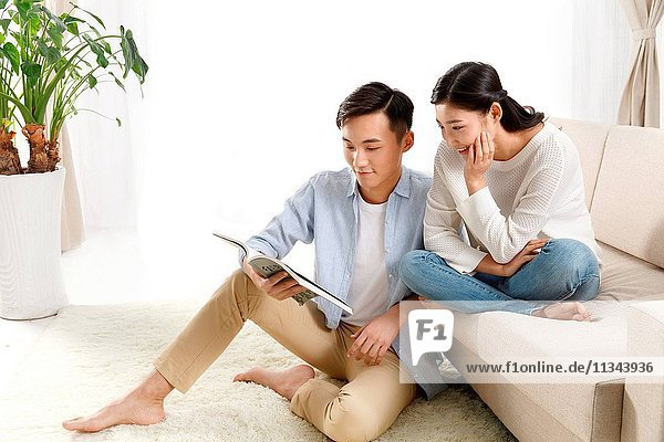 Young lovers reading together