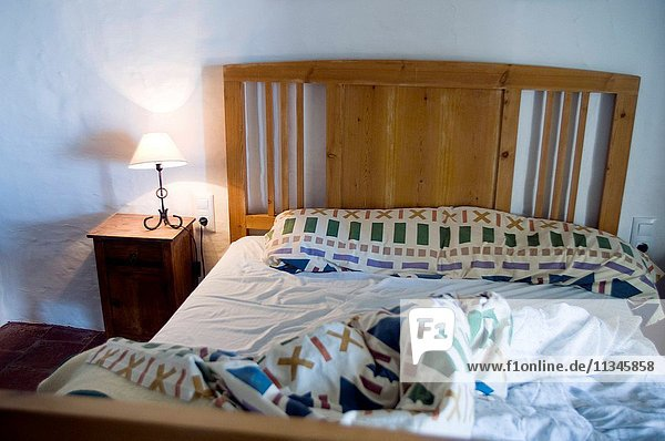 old unmade bed in a house.