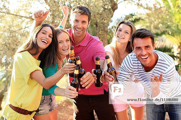 Young people drinking beer