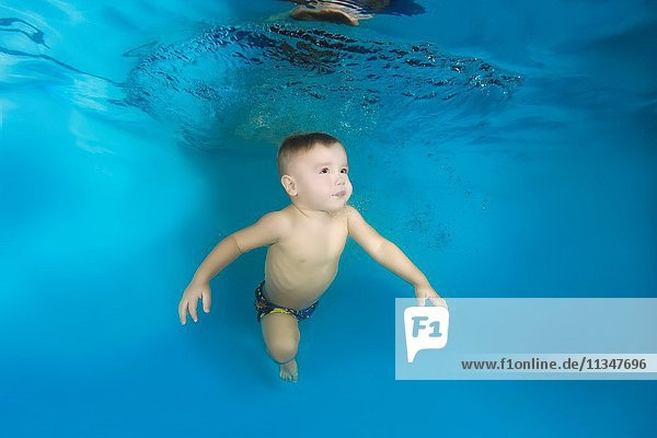2 years boy learning to swim underwater in the pool  Odessa  Ukraine.