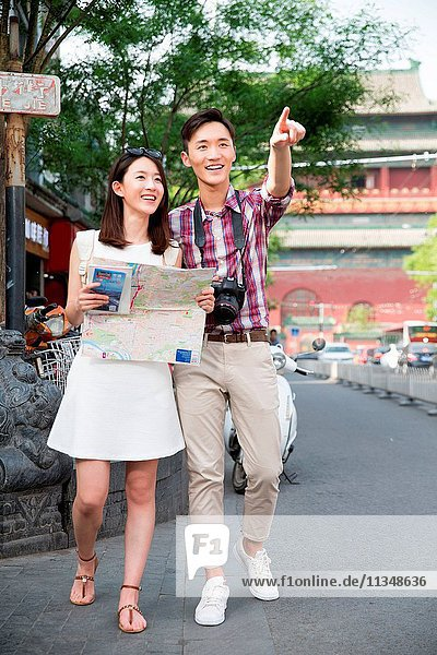 Young couples look at map travel