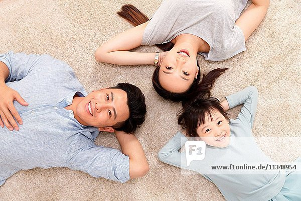 Happy family lying on the ground