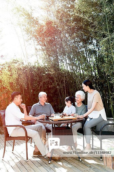 Happy families in the yard to drink tea