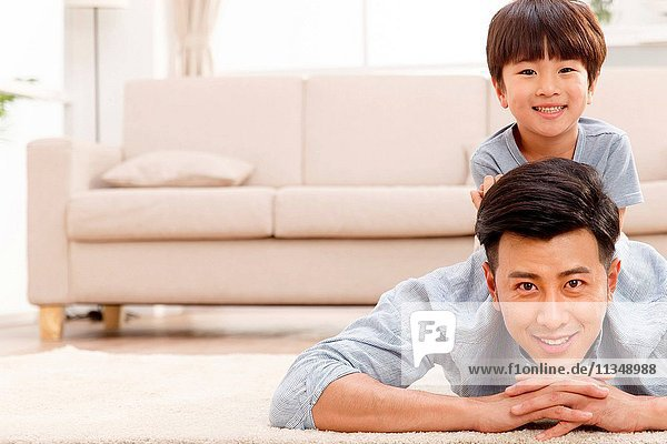 Happy father and son in the living room to play