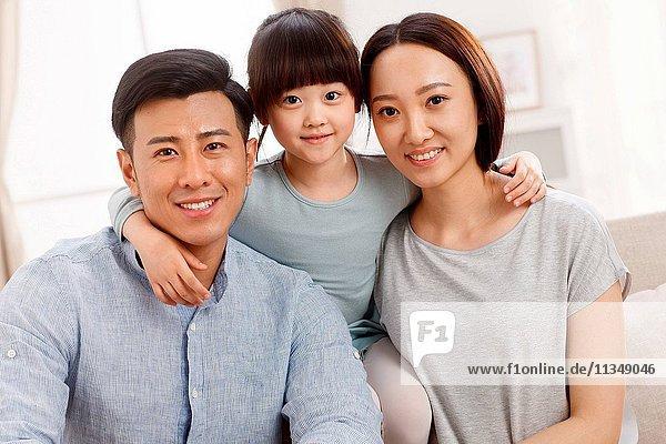 A happy family of three photo