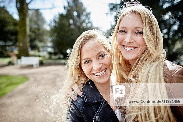 Portrait of smiling female friends in park