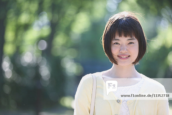 Young Japanese woman in a city park