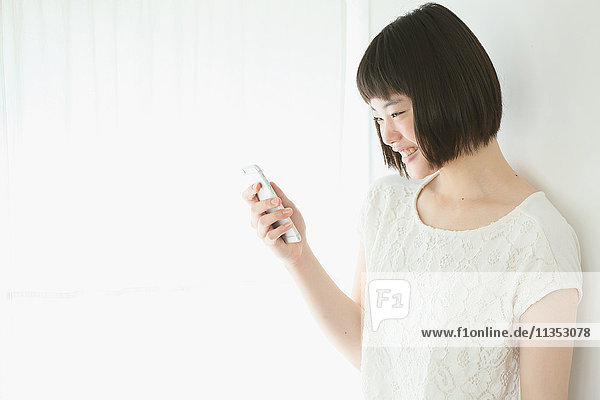 Young Japanese woman with smartphone