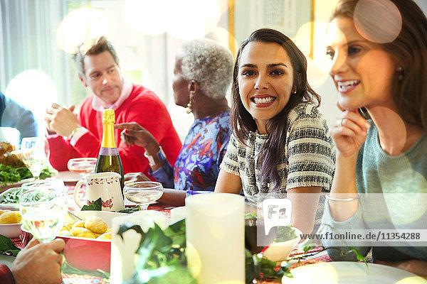 Portrait smiling woman enjoying Christmas dinner at table