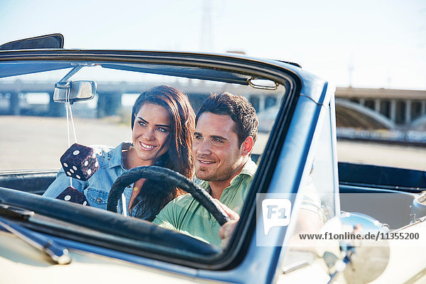 Couple in convertible car  Los Angeles  California  USA