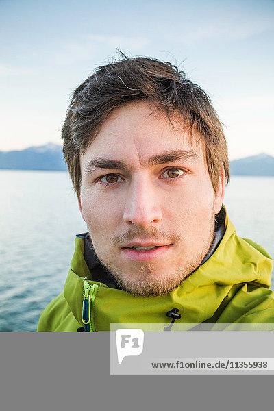 Portrait of man  ocean in background