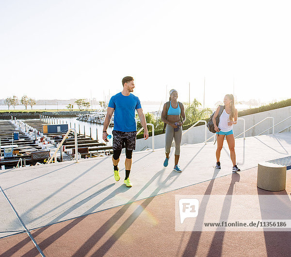 Man and two young women training  talking in sport facility  downtown San Diego  California  USA