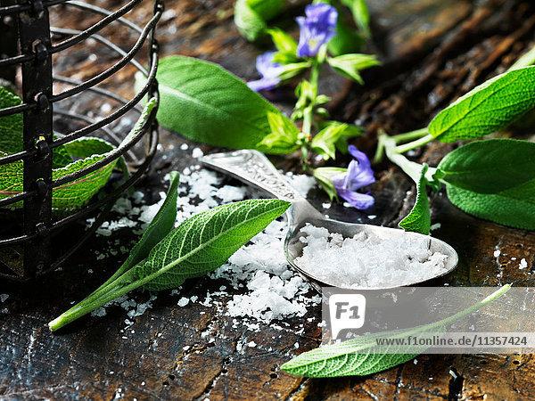 Maldon salt  sage leaves on vintage wooden table