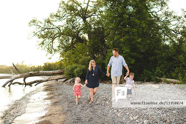 Mid adult parents strolling with boy and girl at Lake Ontario  Oshawa  Canada