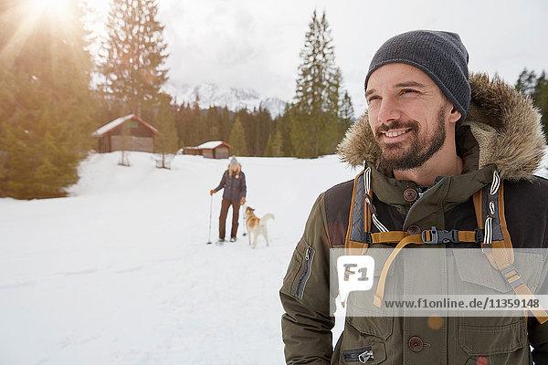 Portrait of mid adult man in winter landscape  Elmau  Bavaria  Germany