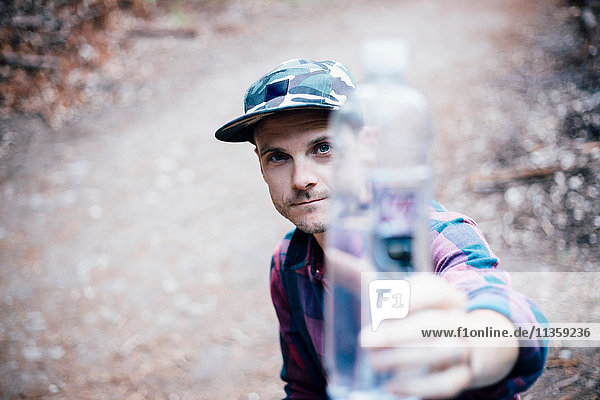 Portrait of man holding water bottle  Big Sur  California  USA