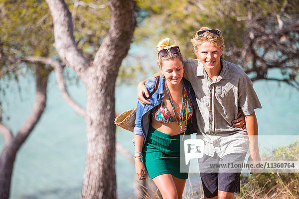 Couple with arms around each other smiling  Majorca  Spain