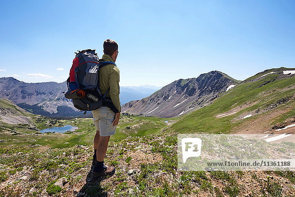 Male backpacker looking out at landscape  Never Summer Wilderness  Colorado  USA