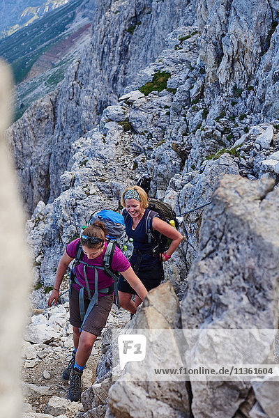 Group of women hiking up mountain smiling  Austria