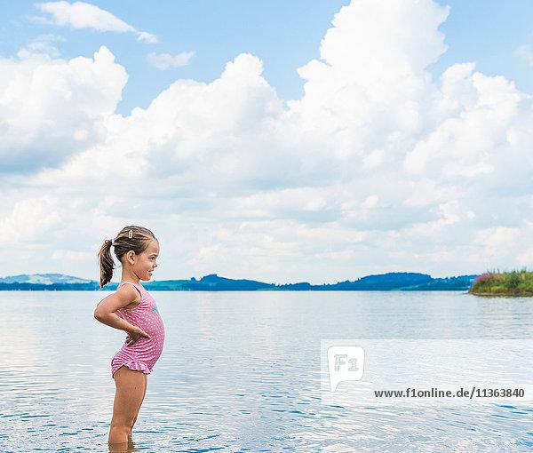 Girl wearing swim suit by lake  looking away  Fuessen  Bavaria  Germany