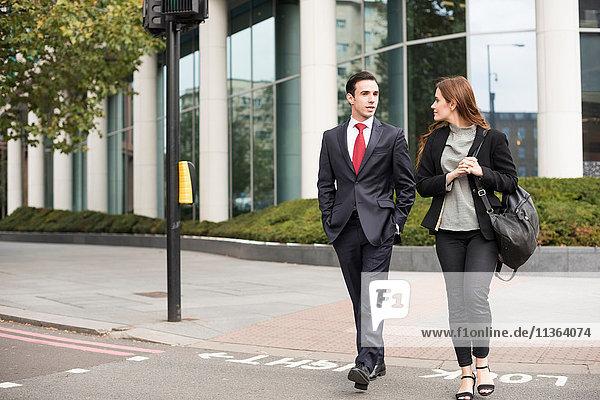 Business people walking in city talking
