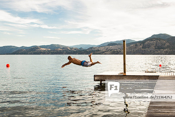 Man diving into lake  Penticton  Canada