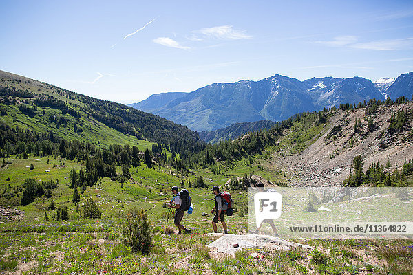 Hikers walking across valley  Enchantments  Alpine Lakes Wilderness  Washington  USA