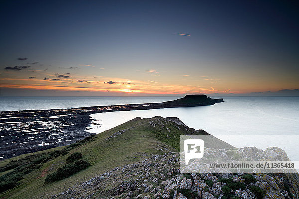 View of Worm's Head at sunset  Rhossili bay  Gower  Wales